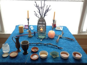 A photo of our Imbolc altar by Weretoad, 2013.