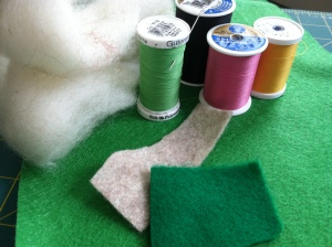 Materials for the gnomes.    I use wool roving to stuff my baby toys.  You can also find wool felt.  Photo by Grey Catsidhe, 2014.