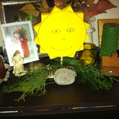 Evergreen and solar imagery on the family altar. Photo by Grey Catsidhe, 2015.
