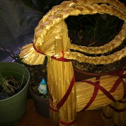 Our beloved Yule Goat hanging around the herbs we brought indoors. Photo by Grey Catsidhe, 2015.